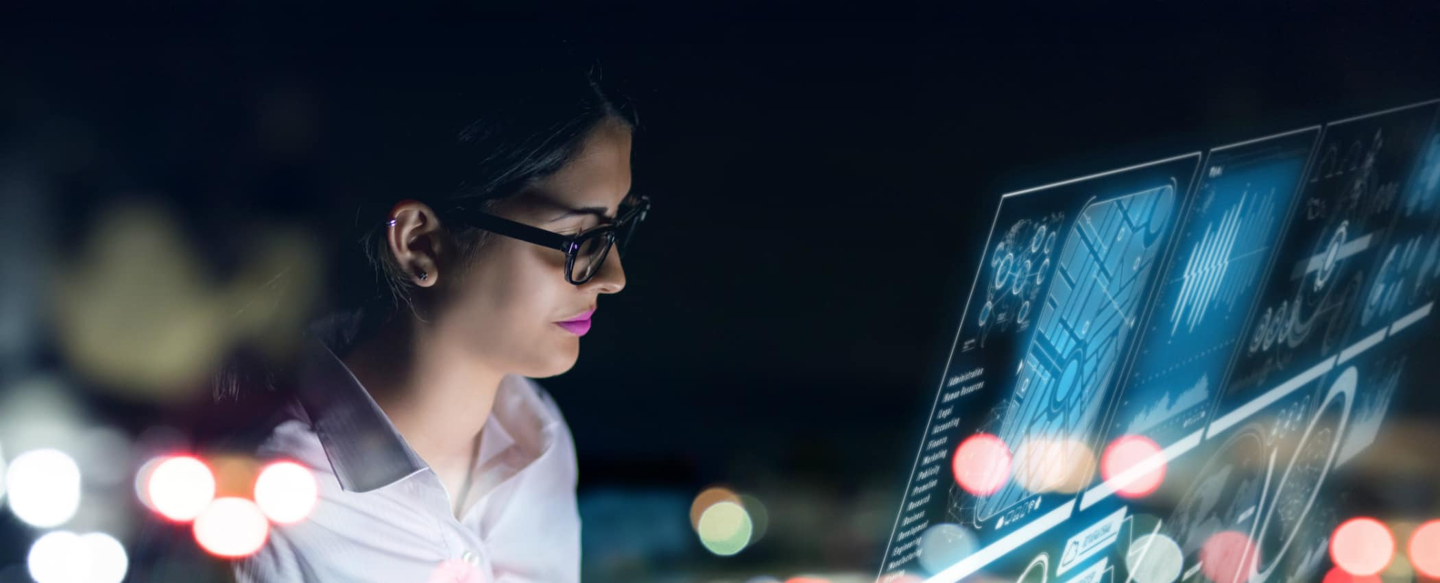 a woman stares at a computer screen