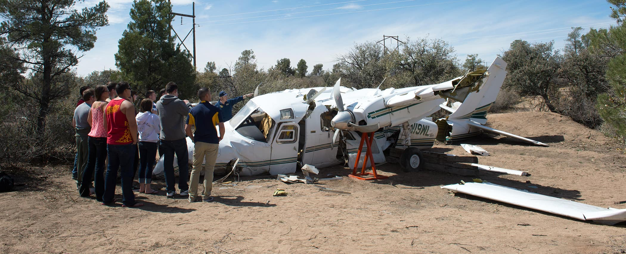 Embry-Riddle Prescott students examine a plane crash