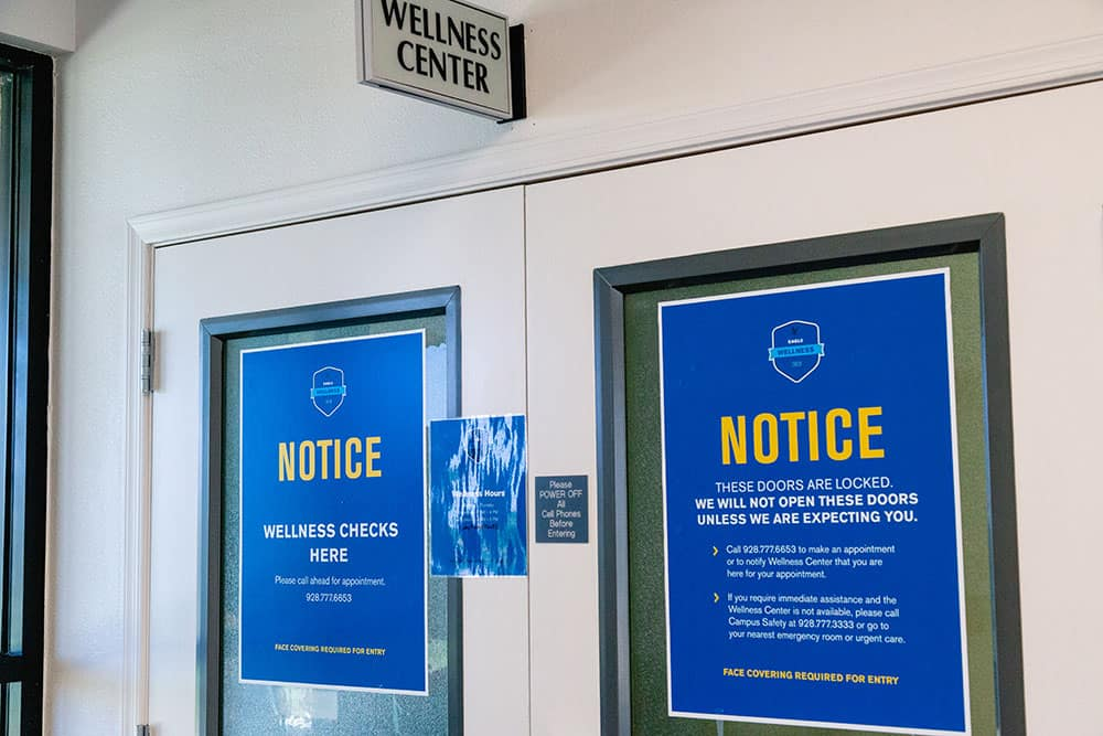 Notices about wellness checks at Wellness Center