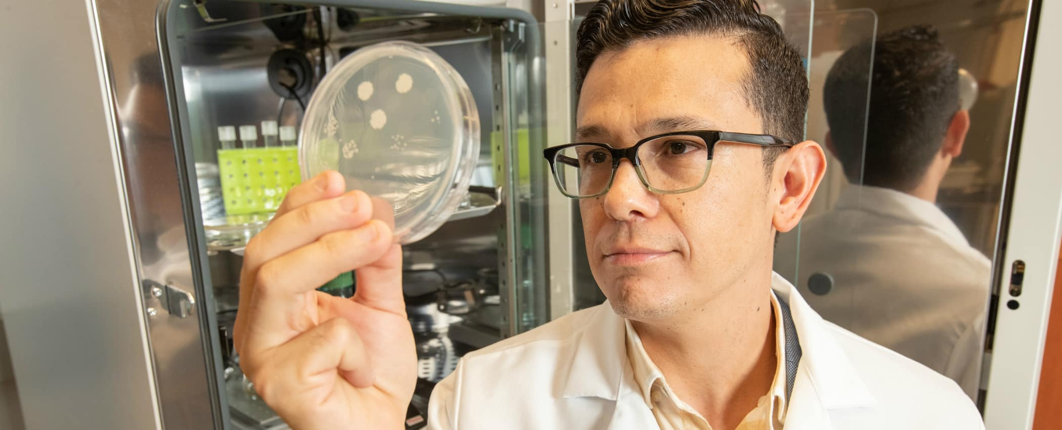 Dr. Hugo Castillo, professor of microbiology in the Aerospace Physiology program at Embry-Riddle Aeronautical University, works in a research lab on the Daytona Beach campus.