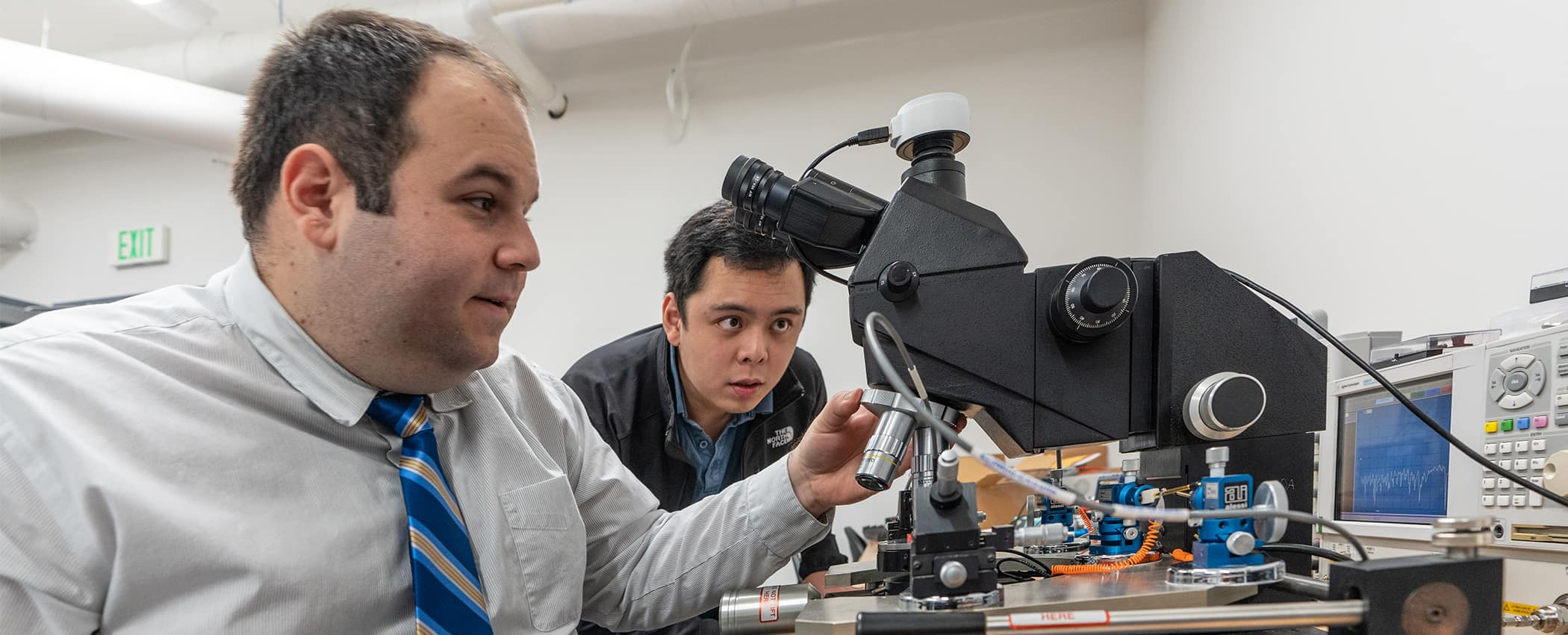 Dr. Eduardo Rojas and a student work on an antenna project.