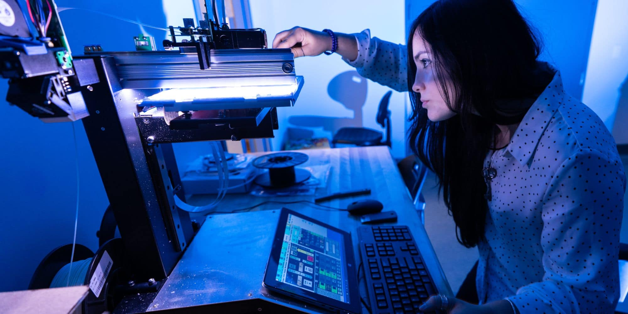 Embry-Riddle Graduate Student Noemi Miguelez works in the parts manufacturing section of the WiDE lab at the MicaPlex