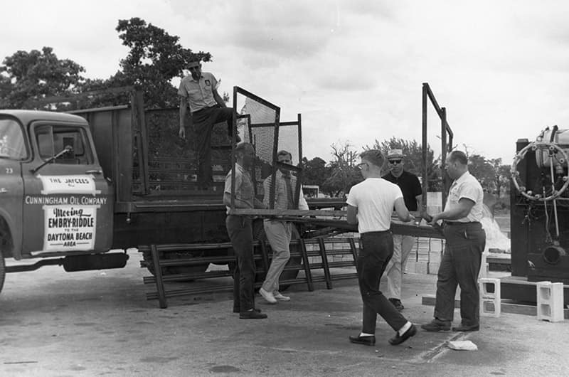 Men loading Embry-Riddle truck