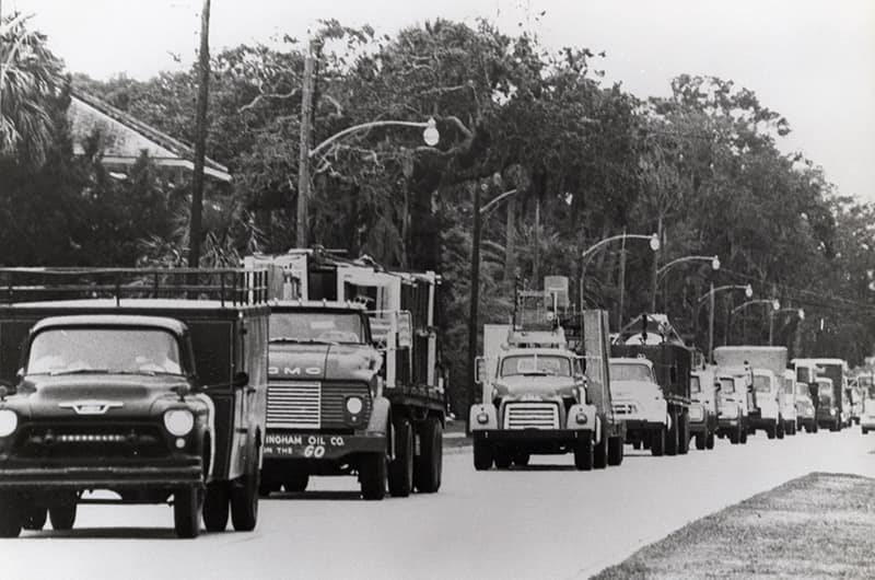 Antique trucks on road