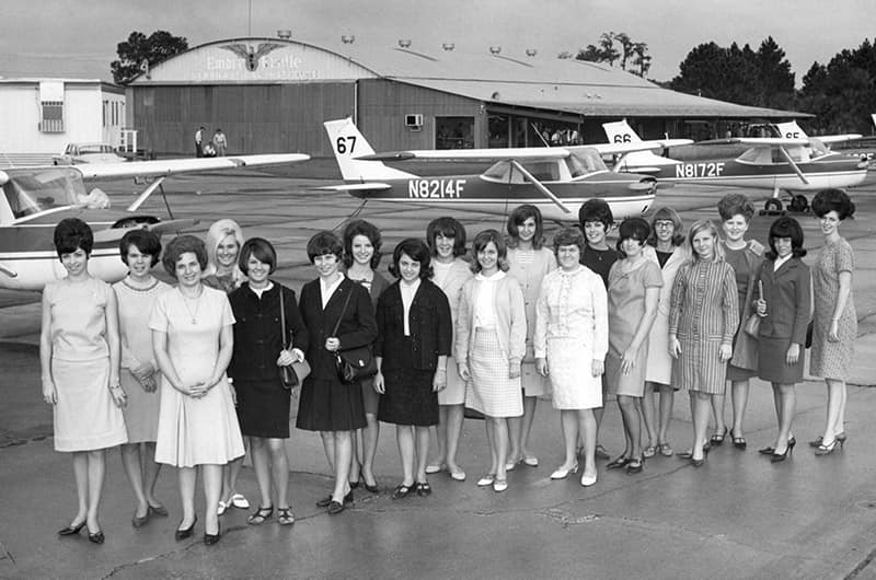 Women in front of planes